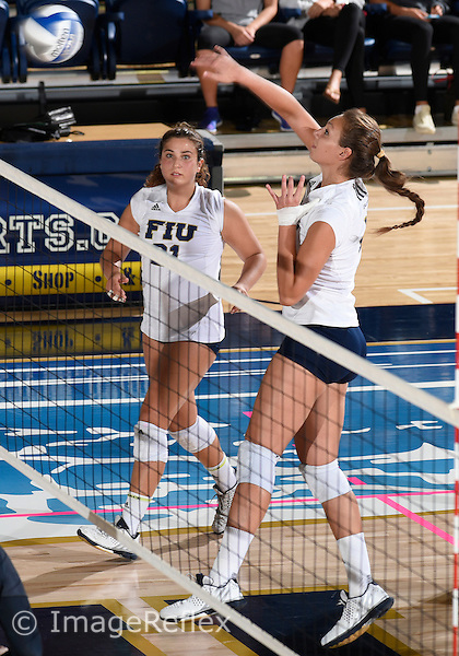 Florida International University women's volleyball middle blocker Gloria Levorin (4) plays against  the University of Central Florida which won the match 3-0 on September 17, 2015 at Miami, Florida.