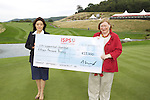 Welsh minister Edwina Hart AM presents Midori Miyazaki from ISPS Handa with a cheque at the ISPS Handa Wales Open 2013 at the Celtic Manor Resort<br /> <br /> 01.09.13<br /> <br /> ©Steve Pope-Sportingwales