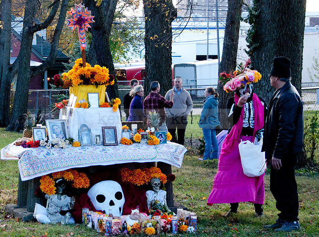 Day of the Dead participants decorate a grave at the Day of the Dead Ceremony in Downtown  Lexington, Ky., on Thursday, November 1, 2012..