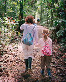 PERU, Amazon Rainforest, South America, Latin America, rear view of mother and daughter hiking in the Amazon Rainforest.