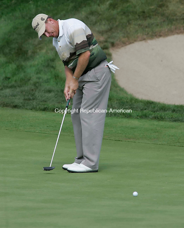 CROMWELL, CT 26 AUGUST 2005 082605B10-  Defending champion Woody Austin putts on #18<br /> during the second round of the Buick Championship at the TPC at River Highlands Friday. <br /> Jamison C. Bazinet / Republican-American