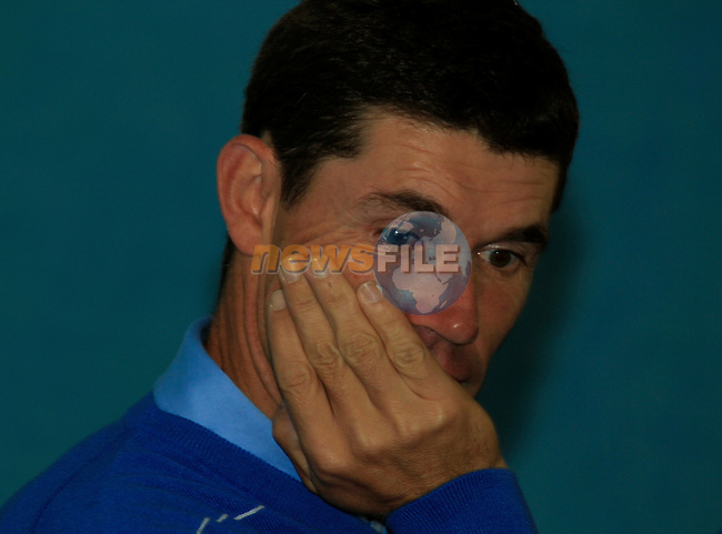Padraig Harrington looking tired at the European Team pictures in the caddy car shed during Practice Day 2 at the 2010 Ryder Cup at the Celtic Manor Twenty Ten Course, Newport, Wales, 29th September 2010..(Picture Eoin Clarke/www.golffile.ie)