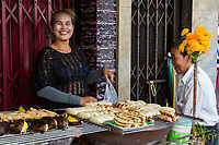 Bangkok, Thailand.  Street Food Vendor Selling Roasted Bananas.