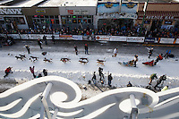 Jeff King leaves the 4th avenue start during the Iditarod 2014 Ceremonial start in downtown Anchorage, Alaska.<br /> <br /> Iditarod Sled Dog Race 2014<br /> PHOTO (c) BY JEFF SCHULTZ/IditarodPhotos.com -- REPRODUCTION PROHIBITED WITHOUT PERMISSION