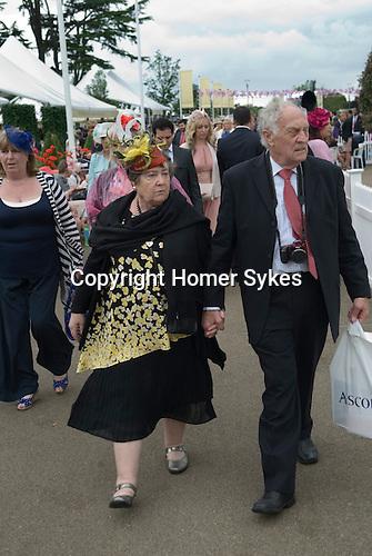 Royal Ascot horse racing Berkshire. 2012 Senior couple holding hands.