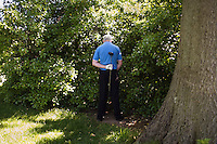 NEW YORK - MAY 19: A golfer, who wished to remain unidentified, made use of some bushes during a round of golf at the Van Cortland Golf Course in the Bronx on Tuesday, May 19, 2009. (photo by Landon Nordeman)