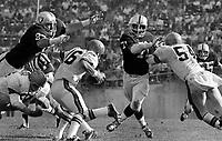 Oakland Raiders Ben Davidson and Ike Lassiter rush Cincinnati Bengal quarterback #16 Horst Muhlmann.<br />(1969 photo/Ron Riesterer)
