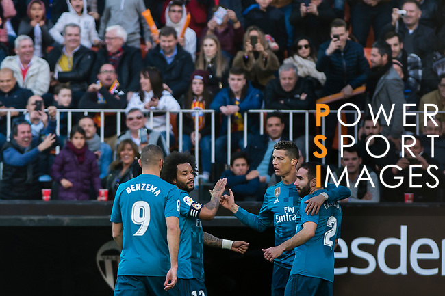 Cristiano Ronaldo of Real Madrid (R2) celebrates after scoring his goal with his teammates during the La Liga 2017-18 match between Valencia CF and Real Madrid at Estadio de Mestalla  on 27 January 2018 in Valencia, Spain. Photo by Maria Jose Segovia Carmona / Power Sport Images