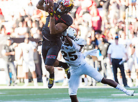 College Park, MD - SEPT 23, 2017: Maryland Terrapins wide receiver D.J. Moore (1) hauls in the Terps loan touchdown on the day against UCF Knights defensive back Kyle Gibson (25) during game between Maryland and UCF at Capital One Field at Maryland Stadium in College Park, MD. (Photo by Phil Peters/Media Images International)