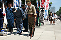 August 15, 2011, Tokyo, Japan - A right-wing group and a man dressed in a WW2 uniform bow their heads during a minutes silence during commemorations marking the end of WW2. (Photo by Bruce Meyer-Kenny/AFLO) [3692]