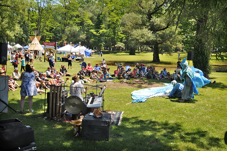 "Arm-of-the-Sea Mask and Puppet Theater troupe, performing ""The Rejuvenary River Circus,""  near the river's edge, on the first day of the Clearwater's Great Hudson River Revival Festival 2013, held at Croton Point Park, in Croton-on-Hudson, NY, June 15, 2013. Photo by Jim Peppler. Copyright Jim Peppler 2013 all rights reserved."