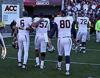 Nov 27, 2010; Charlottesville, VA, USA;  Virginia Cavaliers quarterback Marc Verica (6), Virginia Cavaliers linebacker Darnell Carter (57), Virginia Cavaliers center Danny Aiken (80) and Virginia Cavaliers offensive linesman Oday Aboushi (72) walk off the the field after the game against Virginia Tech at Lane Stadium. Virginia Tech won 37-7. Mandatory Credit: Andrew Shurtleff-