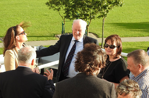 Wave Regatta reception guests enjoy the evening sunshine on the deck at Howth Yacht Club