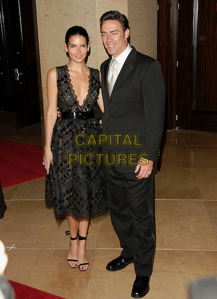 ANGIE HARMON & JASON SEHORN.The 8th Annual Costume Designers Guild Awards Gala held at The Beverly Hilton Hotel in Beverly Hills, California, USA, February 25th 2006.    .full length                                                  .Ref: DVS.www.capitalpictures.com.sales@capitalpictures.com.©Debbie Van Story/Capital Pictures
