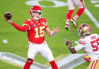 2nd February 2020, Miami Gardens, Florida, USA;  Kansas City Chiefs Quarterback Patrick Mahomes (15) throws the ball under pressure from San Francisco 49ers Defensive End Dee Ford (55) during the NFL Super Bowl LIV  game between the Kansas City Chiefs and the San Francisco 49ers at the Hard Rock Stadium in Miami Gardens
