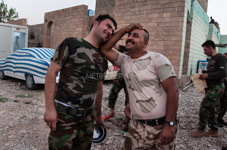 19/07/14  Iraq -- Daquq, Iraq -- Peshmerga fighters joke in front of the camera during a moment of relaxation at the base in Daquq.
