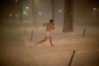 Streakers wearing only underwear run through Harvard Yard in Cambridge, Massachusetts, USA, as Winter Storm Nemo approaches on Friday, Feb. 8, 2013.