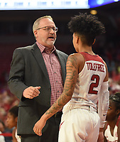 NWA Democrat-Gazette/DAVID GOTTSCHALK Arkansas Razorback head coach Mike Neighbors speaks with Alexis Tolefree  Friday, November 8, 2019, during play against the University of New Orleans Privaters at Bud Walton Arena in Fayetteville.