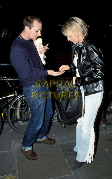 CHRIS TARRANTS WIFE, INGRID..Chris Tarrants wife Ingrid buys her copy of the Big Issue..Ref: 11591..full length, full-length, paparazzi..www.capitalpictures.com..sales@capitalpictures.com..©Capital Pictures