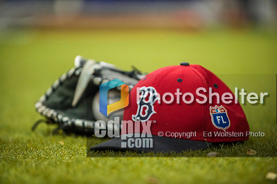 1 April 2016: A Boston Red Sox cap, glove, and ball lie on the infield turf prior to a pre-season exhibition game between the Red Sox and the Toronto Blue Jays at Olympic Stadium in Montreal, Quebec, Canada. The Red Sox defeated the Blue Jays 4-2 in the first of two MLB weekend exhibition games, which saw an attendance of 52,682 at the former home on the Montreal Expos. Mandatory Credit: Ed Wolfstein Photo *** RAW (NEF) Image File Available ***