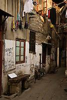 Narrow street with hanging laundry, Shanghai, China