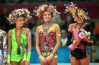 "(L-R) Evgenia Kanaeva, Olga Kapranova of Russia, Anna Bessonova of Ukraine smile  during All-Around awards ceremony at 2007 World Cup Kiev, ""Deriugina Cup"" in Kiev, Ukraine on March 17, 2007. Anna Bessonova won the seniors All-Around."