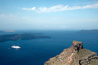 A cruise ship in the bay seen from Imerovigli, balcony to the Aegean, an area in Fira village, Santorini, Greece