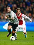Nederland, Amsterdam, 3 november 2012.Eredivisie.Seizoen 2012-2013.Ajax-Vitesse (0-2).Theo Janssen (l.) van Vitesse in actie met bal. Rechts Lasse Schone van Ajax.
