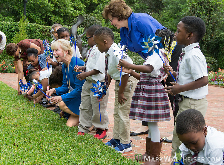 "First Lady Ann Scott, center left, helps plant pinwheels after  a press conference to launch Prevent Child Abuse with Florida's annual ""Pinwheels for Prevention"" campaign at the Florida Governor's Mansion."