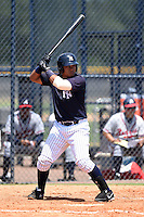 GCL Yankees 1 catcher Alvaro Noriega (13) at bat during the first game of a doubleheader against the GCL Braves on July 1, 2014 at the Yankees Minor League Complex in Tampa, Florida.  GCL Yankees 1 defeated the GCL Braves 7-1.  (Mike Janes/Four Seam Images)