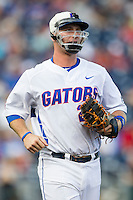Florida Gators first baseman Peter Alonso (20) against the Miami Hurricanes in the NCAA College World Series on June 13, 2015 at TD Ameritrade Park in Omaha, Nebraska. Florida defeated Miami 15-3. (Andrew Woolley/Four Seam Images)