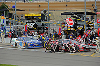 Kevin Harvick (#29) and Bobby Labonte, (#47) Reese Tow Power Camry make pit stops.