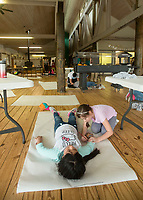 NWA Democrat-Gazette/BEN GOFF @NWABENGOFF<br /> Joslyn Hernandez (left) and Camila Bravo, 4th graders from Brighton Park school in Chicago, take turns tracing each other for a project Friday, April 13, 2018, at Ozark Natural Science Center near Huntsville. The 4th grade students from Brighton Park, a public charter school, are visiting for a five day immersive environmental education program.