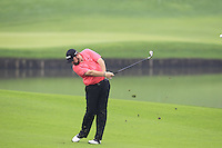 Shane Lowry (IRL) plays his 2nd shot on the 11th hole during Friday's Round 2 of the 2014 BMW Masters held at Lake Malaren, Shanghai, China 31st October 2014.<br /> Picture: Eoin Clarke www.golffile.ie