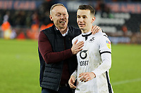 (L-R) Swansea City manager Steve Cooper congratulates Bersant Celina of Swansea City during the Sky Bet Championship match between Swansea City and Wigan Athletic at the Liberty Stadium, Swansea, Wales, UK. Saturday 19 January 2020
