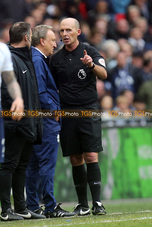 referee Mike Dean has a word with Cardiff City manager Neil Warnock during Tottenham Hotspur vs Cardiff City, Premier League Football at Wembley Stadium on 6th October 2018