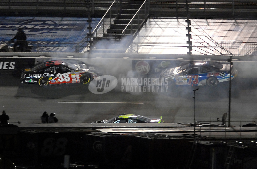 May 4, 2007; Richmond, VA, USA; Nascar Busch Series driver Jason Leffler (38) crashes during the Circuit City 250 at Richmond International Raceway. Mandatory Credit: Mark J. Rebilas