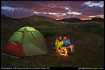 "Experiment! Not everything is done in Photoshop. <br /> Photos like this are pretty easy. The overall scene was lit by a rising full moon, full moon, John and Beth camping, Loveland Pass, Loveland Pass camping trip, night lights, tent, which lasted just a few minutes due to cloud cover. A headlamp lit the tent. Our ""campfire"" was a candle surrounded by aluminum foil. I used a tripod and a 7 second exposure. Photoshop was only used to lighten certain areas.<br /> John and Beth backpacking at 12"