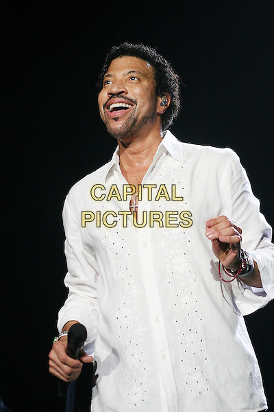 LIONEL RICHIE.Live in concert at the Wembley Arena, London, England..March 23rd, 2007 .stage concert gig performance music half length white shirt goatee facial hair.CAP/MAR.© Martin Harris/Capital Pictures.