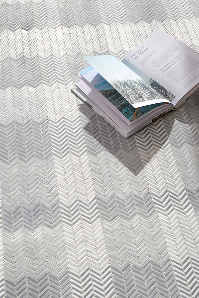 Gingham, a hand-cut tumbled mosaic, shown in Bardiglio, Celeste, Calacatta, and Thassos, is part of the Tissé® collection for New Ravenna.