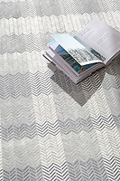 Gingham, a hand-cut tumbled mosaic, shown in Bardiglio, Celeste, Calacatta, and Thassos, is part of the Tissé™ collection for New Ravenna.