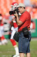 Wire Image sports photographer and author G. Newman Lowrance takes some pictures before the game between the Chiefs and Seattle Seahawks at Arrowhead Stadium  in Kansas City, Missouri on October 29, 2006. Kansas City won 35-28.
