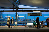 Passengers on London Blackfriars station platform, and City of London at dusk.