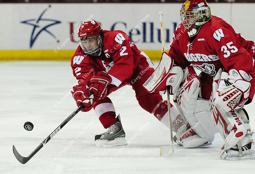 "6'2"" junior Jamie McBain (left) lends a helping hand to Badger goalkeeper Shane Connelly in the first period Saturday night, as the Badgers go up against Alabama-Huntsville at the Kohl Center"