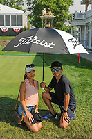Avid golf fans make their own shade near the fountain on the 16th tee during Thursday's first round of the 72nd U.S. Women's Open Championship, at Trump National Golf Club, Bedminster, New Jersey. 7/13/2017.<br /> Picture: Golffile | Ken Murray<br /> <br /> <br /> All photo usage must carry mandatory copyright credit (&copy; Golffile | Ken Murray)