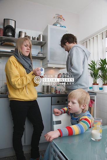 White family in kitchen.