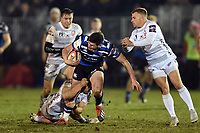 Freddie Burns of Bath Rugby takes on the Gloucester Rugby defence. Premiership Rugby Cup match, between Bath Rugby and Gloucester Rugby on February 3, 2019 at the Recreation Ground in Bath, England. Photo by: Patrick Khachfe / Onside Images