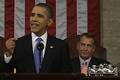 Speaker of the United States House of Representatives John Boehner (Republican of Ohio), right, listens at right as U.S. President Barack Obama gives his State of the Union address during a joint session of Congress on Capitol Hill in Washington, DC on February 12, 2013.     .Credit: Charles Dharapak / Pool via CNP