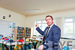 Paul Moran Principal shows the Water damage on the ceiling of Holy Family NS Rathmore