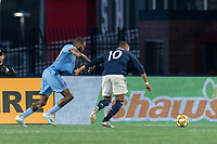 FOXBOROUGH, MA - SEPTEMBER 29: Teal Bunbury #10 of New England Revolution dribbles as Sebastien Ibeagha #33 of New York City FC defends during a game between New York City FC and New England Revolution at Gillette Stadium on September 29, 2019 in Foxborough, Massachusetts.